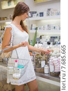 Купить «Woman with shopping basket testing soap», фото № 7685665, снято 3 марта 2015 г. (c) Wavebreak Media / Фотобанк Лори