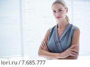 Купить «Thoughtful businesswoman standing in the office», фото № 7685777, снято 14 марта 2015 г. (c) Wavebreak Media / Фотобанк Лори