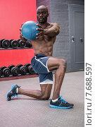 Купить «Young bodybuilder doing excercises», фото № 7688597, снято 13 февраля 2015 г. (c) Wavebreak Media / Фотобанк Лори