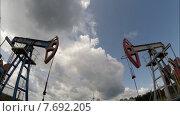 Купить «Нефтяные насосы. Оборудование для нефтяной промышленности.», видеоролик № 7692205, снято 16 июля 2015 г. (c) Mikhail Erguine / Фотобанк Лори