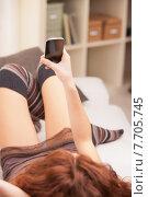 Купить «Red Headed very cute girl texting on a mobile», фото № 7705745, снято 16 июня 2019 г. (c) PantherMedia / Фотобанк Лори