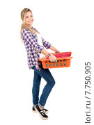 Купить «Positive young woman doing the laundry at home», фото № 7750905, снято 20 июля 2019 г. (c) PantherMedia / Фотобанк Лори