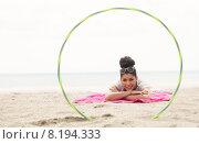 Купить «Smiling woman looking at camera through hula hoop», фото № 8194333, снято 20 мая 2015 г. (c) Wavebreak Media / Фотобанк Лори