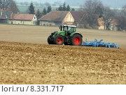 Купить «tractor at work on a field», фото № 8331717, снято 22 мая 2018 г. (c) PantherMedia / Фотобанк Лори