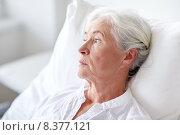 Купить «senior woman patient lying in bed at hospital ward», фото № 8377121, снято 11 июня 2015 г. (c) Syda Productions / Фотобанк Лори