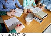 Купить «close up of hands with books writing to notebooks», фото № 8377469, снято 6 марта 2015 г. (c) Syda Productions / Фотобанк Лори