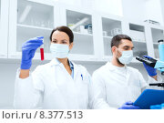 Купить «young scientists making test or research in lab», фото № 8377513, снято 4 декабря 2014 г. (c) Syda Productions / Фотобанк Лори