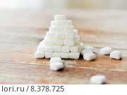 Купить «close up of white sugar pyramid on wooden table», фото № 8378725, снято 22 мая 2015 г. (c) Syda Productions / Фотобанк Лори