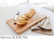 Купить «close up of white bread or baguette and knife», фото № 8378733, снято 22 мая 2015 г. (c) Syda Productions / Фотобанк Лори