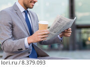 Купить «close up of smiling businessman reading newspaper», фото № 8379093, снято 19 августа 2014 г. (c) Syda Productions / Фотобанк Лори