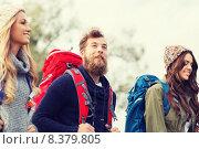 Купить «group of smiling friends with backpacks hiking», фото № 8379805, снято 31 августа 2014 г. (c) Syda Productions / Фотобанк Лори