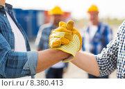 close up of builders hands making handshake. Стоковое фото, фотограф Syda Productions / Фотобанк Лори