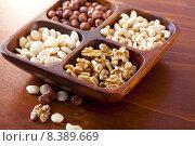 Купить «bowl nuts nusssorten mixed composition», фото № 8389669, снято 19 ноября 2017 г. (c) PantherMedia / Фотобанк Лори