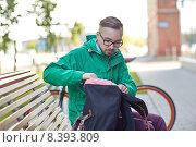 Купить «hipster man with backpack sitting on city bench», фото № 8393809, снято 30 мая 2015 г. (c) Syda Productions / Фотобанк Лори