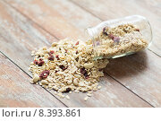 Купить «close up of jar with granola or muesli on table», фото № 8393861, снято 28 апреля 2015 г. (c) Syda Productions / Фотобанк Лори
