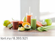 Купить «close up of fresh juice glass and fruits on table», фото № 8393921, снято 17 марта 2015 г. (c) Syda Productions / Фотобанк Лори