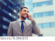 Купить «smiling businessman with smartphone outdoors», фото № 8394813, снято 19 августа 2014 г. (c) Syda Productions / Фотобанк Лори