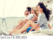 Купить «smiling friends sitting on yacht deck», фото № 8395853, снято 13 июля 2014 г. (c) Syda Productions / Фотобанк Лори