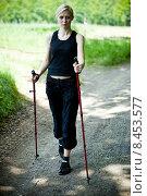 Купить «Nordic Walking - young woman is hiking», фото № 8453577, снято 24 июня 2019 г. (c) PantherMedia / Фотобанк Лори
