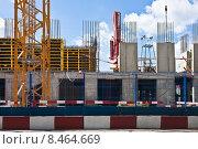 Купить «Строительство многоэтажного дома», фото № 8464669, снято 31 июля 2015 г. (c) Victoria Demidova / Фотобанк Лори