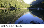 Купить «Озеро Бадукское в горах Кавказа», эксклюзивный видеоролик № 8471537, снято 25 июля 2015 г. (c) Алексей Бок / Фотобанк Лори