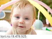 Купить «Счастливый маленький ребенок на фоне игрушек», фото № 8478925, снято 3 сентября 2013 г. (c) Олег Хархан / Фотобанк Лори