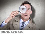 Купить «Composite image of spy looking through magnifier», фото № 8913565, снято 19 октября 2018 г. (c) Wavebreak Media / Фотобанк Лори