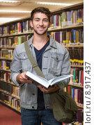 Купить «Composite image of student smiling at camera in library», фото № 8917437, снято 24 мая 2019 г. (c) Wavebreak Media / Фотобанк Лори