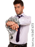 Купить «Businessman chained with padlock, job slave symbol, isolated on white background», фото № 9047673, снято 16 декабря 2018 г. (c) PantherMedia / Фотобанк Лори