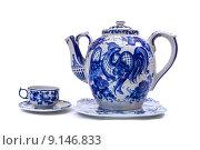 Чайник и чашка с узорами. Стоковое фото, фотограф Денис Приходько-Муханов / Фотобанк Лори