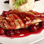 Chicken grill with rice and cherry sauce. Closeup, фото № 9169181, снято 3 декабря 2016 г. (c) PantherMedia / Фотобанк Лори