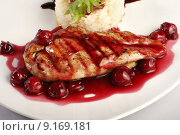 Купить «Chicken grill with rice and cherry sauce. Closeup», фото № 9169181, снято 8 мая 2019 г. (c) PantherMedia / Фотобанк Лори