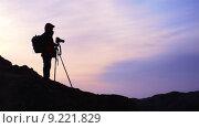 Купить «Photographer at sunrise», фото № 9221829, снято 20 июня 2019 г. (c) PantherMedia / Фотобанк Лори