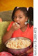 Little Girl Eats Popcorn. Стоковое фото, фотограф Scott Griessel / PantherMedia / Фотобанк Лори