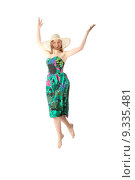 Купить «Happy young blond woman in summer colorfull dress jumping, isolated on white», фото № 9335481, снято 25 июня 2019 г. (c) PantherMedia / Фотобанк Лори
