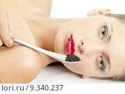 Купить «portrait of lying woman with black caviar», фото № 9340237, снято 26 марта 2019 г. (c) PantherMedia / Фотобанк Лори