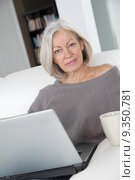 Купить «Senior woman relaxing at home in front of laptop computer», фото № 9350781, снято 19 апреля 2019 г. (c) PantherMedia / Фотобанк Лори