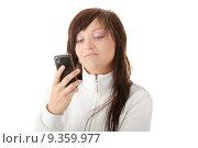 Купить «Young caucasian woman typing messege on her mobilephone isolated on white background», фото № 9359977, снято 25 марта 2019 г. (c) PantherMedia / Фотобанк Лори