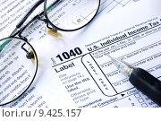 Купить «Working on the United States Income Tax 1040», фото № 9425157, снято 24 августа 2019 г. (c) PantherMedia / Фотобанк Лори