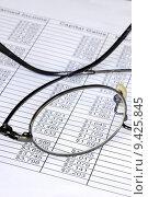 Купить «Check the numbers on the spreadsheet with shallow DOF», фото № 9425845, снято 20 сентября 2018 г. (c) PantherMedia / Фотобанк Лори