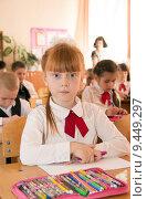 Купить «Девочка на уроке», фото № 9449297, снято 23 мая 2015 г. (c) Олег Хархан / Фотобанк Лори