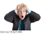Купить «Испуганный мальчик в деловом костюме, изолировано на белом фоне», фото № 9527085, снято 8 августа 2015 г. (c) Кекяляйнен Андрей / Фотобанк Лори