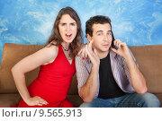 Купить «Angry Woman with Man on Phone», фото № 9565913, снято 10 июля 2020 г. (c) PantherMedia / Фотобанк Лори