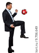 Купить «one business man playing juggling soccer ball», фото № 9706649, снято 21 июня 2019 г. (c) PantherMedia / Фотобанк Лори