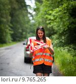 Купить «Young female driver having a car breakdown», фото № 9765265, снято 24 августа 2019 г. (c) PantherMedia / Фотобанк Лори