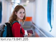 Купить «Portrait of a young woman boarding an aircraft», фото № 9841205, снято 17 сентября 2019 г. (c) PantherMedia / Фотобанк Лори