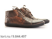 Купить «A pair of man's leather shoes isolated on white», фото № 9844497, снято 27 мая 2019 г. (c) PantherMedia / Фотобанк Лори
