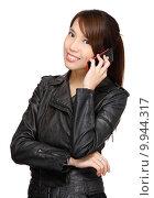 Купить «asian young woman talking on phone», фото № 9944317, снято 6 декабря 2019 г. (c) PantherMedia / Фотобанк Лори