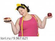 Купить «Large girl with a cake in one hand and an apple in the other», фото № 9967621, снято 14 декабря 2017 г. (c) PantherMedia / Фотобанк Лори