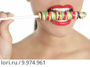 Купить «Colorful Lollypop in perfect woman teeth», фото № 9974961, снято 18 июня 2019 г. (c) PantherMedia / Фотобанк Лори
